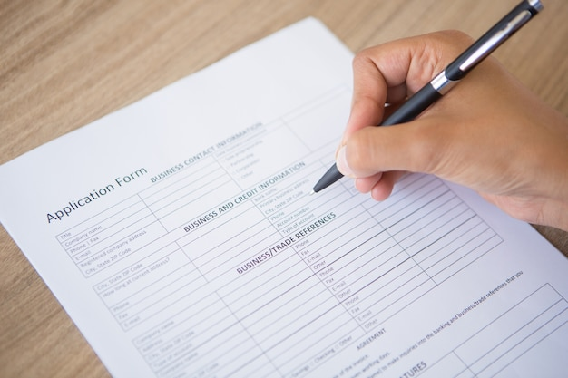 Hand Completing Application Form Photo | Free Download