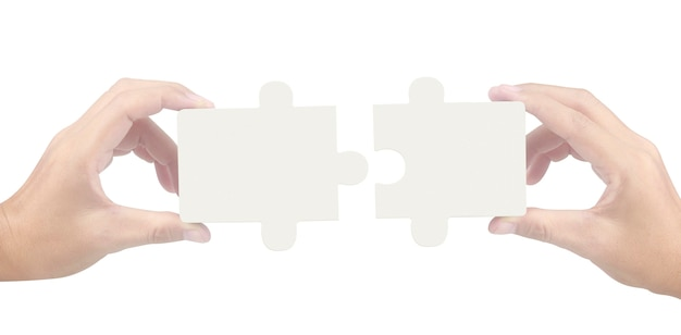 Hand of connecting jigsaw puzzle,concept of teamwork. isolated Premium Photo