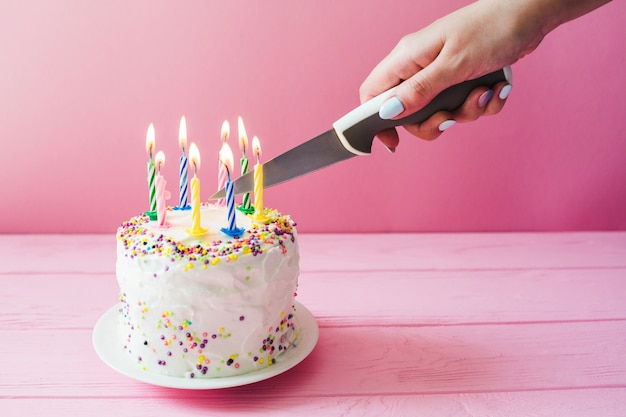 Hand Cutting Cake With Candles Photo Free Download