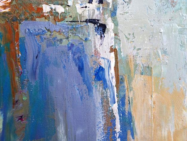 手はキャンバスに油絵ベージュ色ブラシストロークテクスチャ抽象的な背景を描きます。 Premium写真