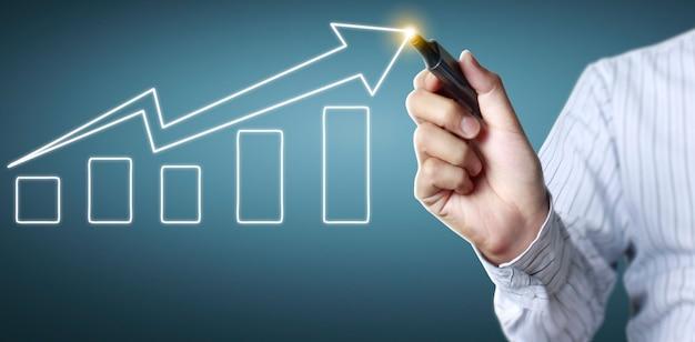 チャートを描く手、成長のグラフストック Premium写真
