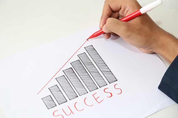 Hand drawing business success graph Premium Photo