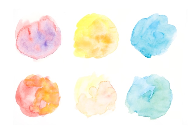 Hand drawn colorful circular splatter on white backdrop Free Photo