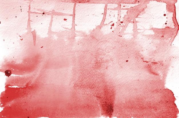 手描きの赤い水彩図形。創造的な塗装の背景、手作りの装飾 Premium写真