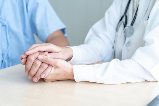 Hand of female doctor holding on her senior patient Premium Photo