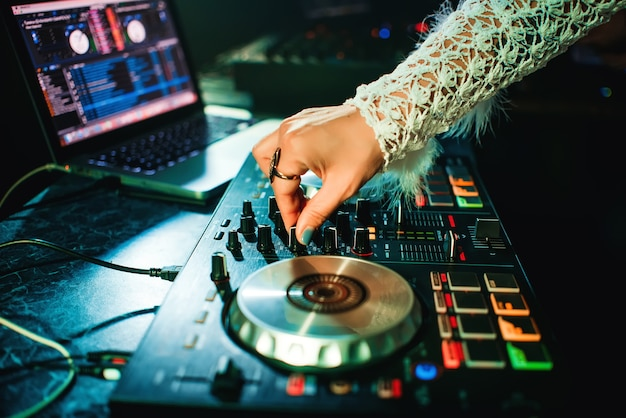 Hand girl dj with make-up and ring mixing music Premium Photo
