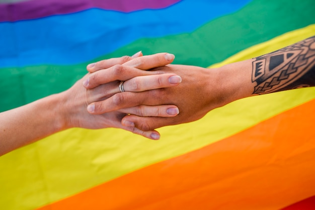 Hand in hand same-sex couple Free Photo