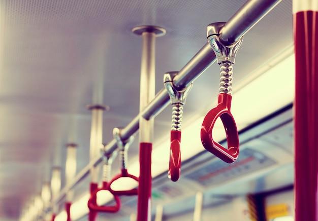 Hand handle commuting public transportation Free Photo