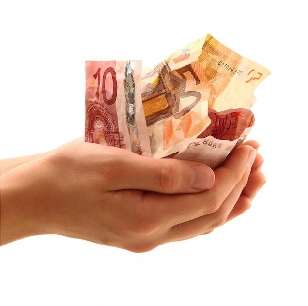 Hand held money in white Premium Photo