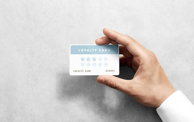 Hand hold discount card mockup with rounded corners Premium Photo