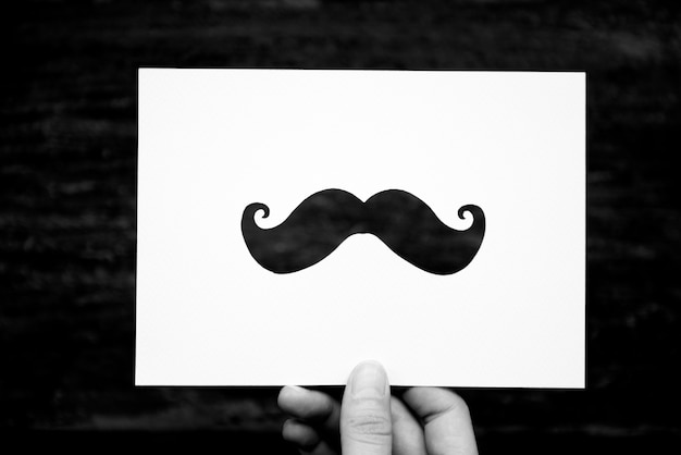 Hand Hold Mustache Paper Carving Free Photo