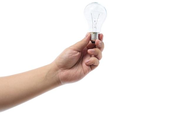 Рука, проведение лампа накаливания, изолированных на белом фоне Premium Фотографии