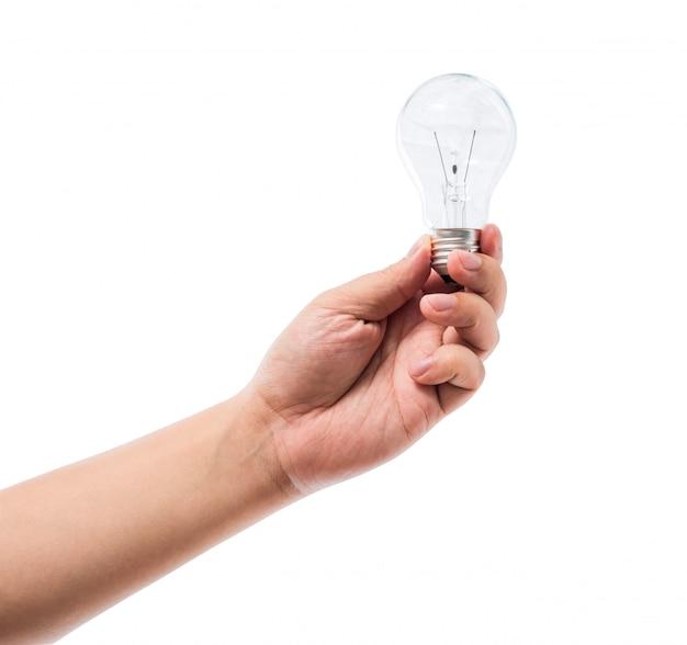 Рука лампочку накаливания изолированы Premium Фотографии