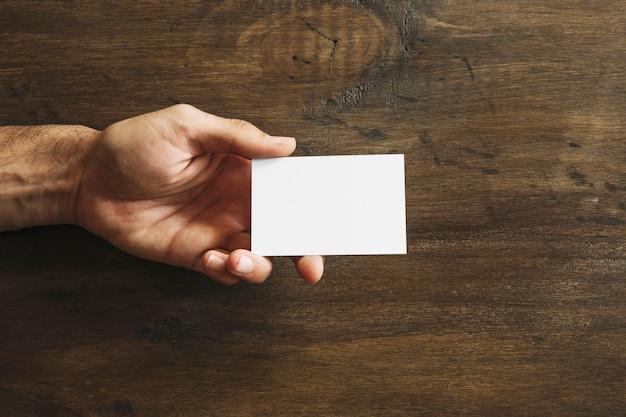 Hand holding blank business card photo free download hand holding blank business card free photo colourmoves