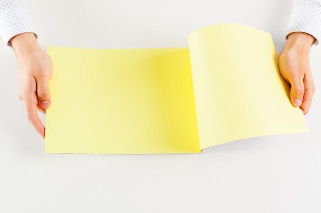 Hand holding blank opened book Premium Photo
