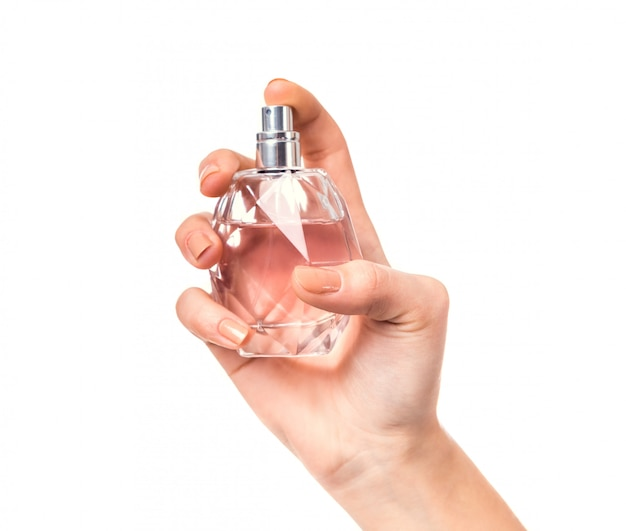 Hand holding a bottle of perfume Premium Photo