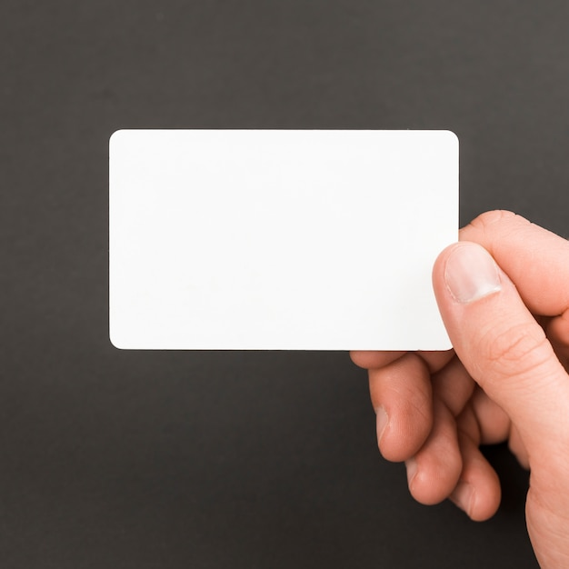 Hand holding business card Free Photo