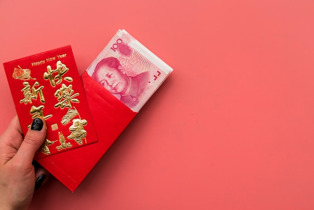 Hand holding card and chinese bills Free Photo