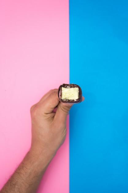 Hand holding a chocolate and mint ice cream. Premium Photo