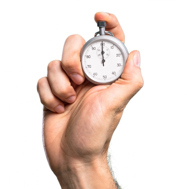 Hand holding chronometer over isolated white background Premium Photo