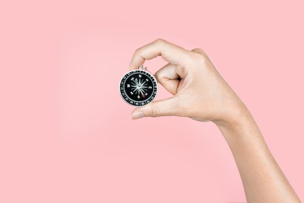 Hand holding compass in the travel concept Premium Photo