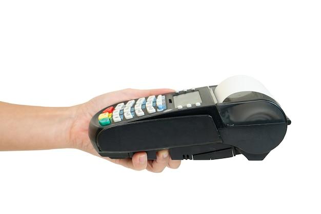 Рука, держащая машину смахивания кредитной карты на белом Premium Фотографии
