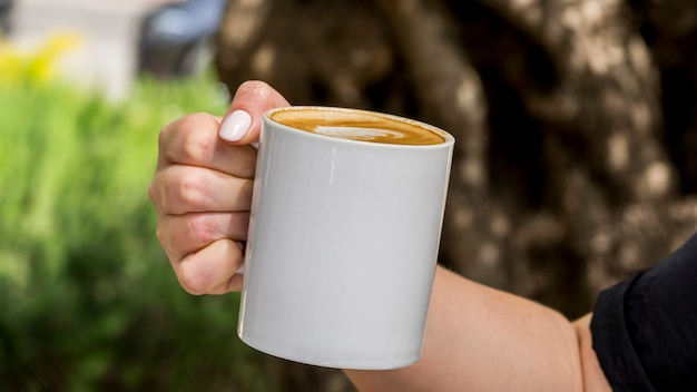 Hand holding cup of coffee Free Photo