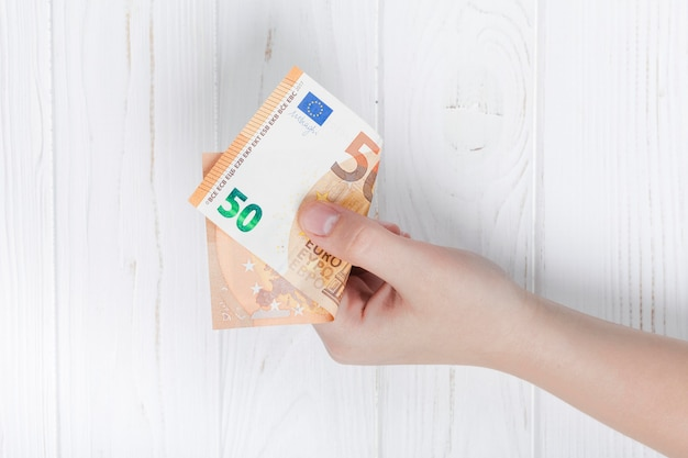 Hand holding a euro bank-note Free Photo