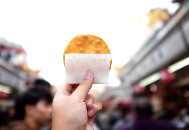hand holding food japanese cracker photo free download