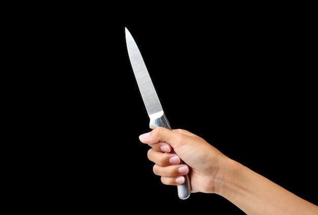 Hand holding knife on black background Premium Photo