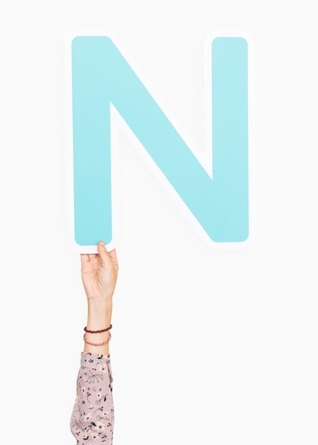 Hand holding the letter n Free Photo