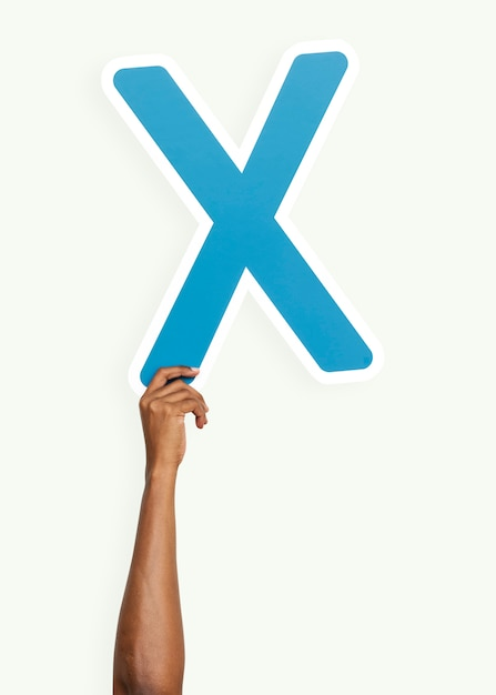 Hand holding the letter x Free Photo