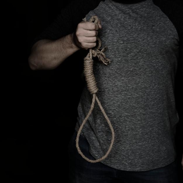 Hand holding loop rob with black background Premium Photo