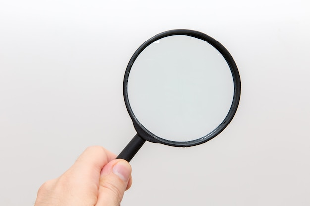 Hand holding magnifying glass Premium Photo