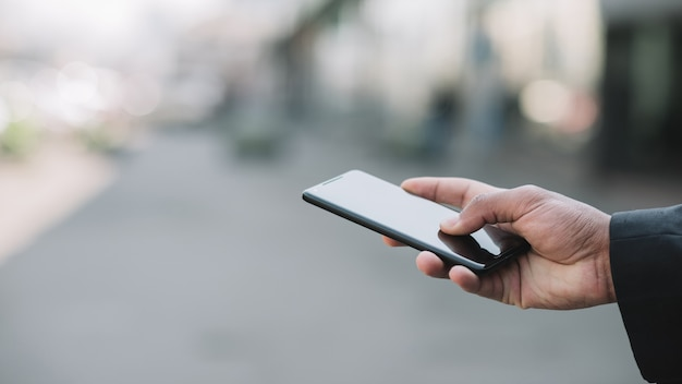 Hand holding mobile device close up Free Photo