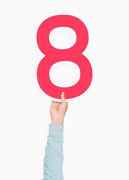 Hand holding number eight sign Free Photo