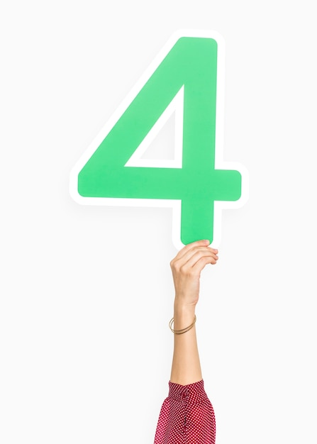 Hand holding number four sign Free Photo