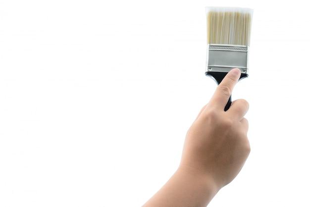 Hand holding paint brush with plastic black handle isolated Premium Photo