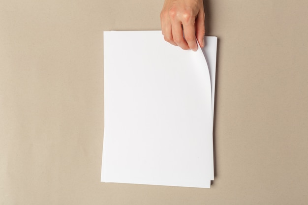 Hand holding papers a4 size Premium Photo