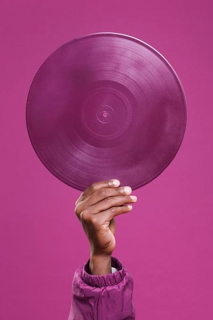 Hand holding purple vinyl Free Photo