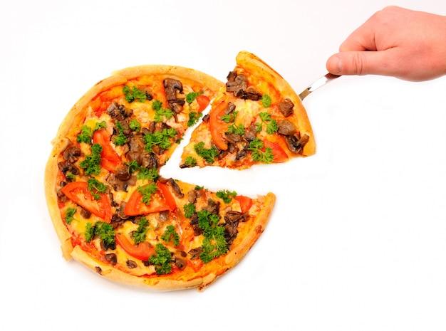 ピザのスライスを持っている手 Premium写真
