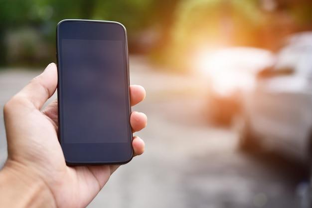 Hand holding smart phone ,mobile phone technology internet online business Premium Photo