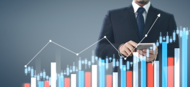 Hand holding smartphone device and touching screen. stock exchange market concept Premium Photo