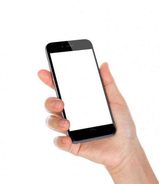 Hand holding a smartphone with blank screen and white background Free Photo