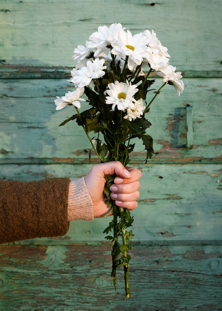 Hand holding spring flowers bouquet Free Photo