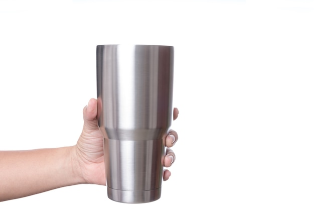 Hand holding stainless steel thermos mug for keeping  temperature like iced of hot water Premium Photo