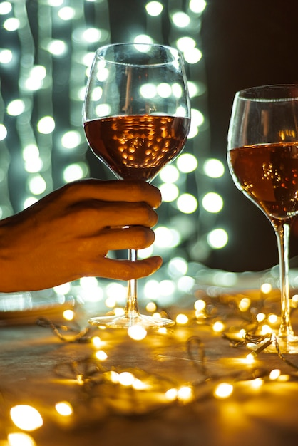 Hand holding transparent glass of wine Free Photo