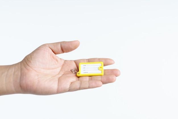 Hand holding travel luggage tag Premium Photo
