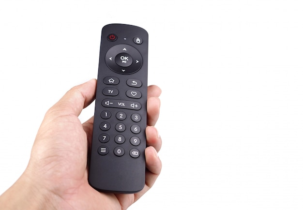 Hand holding tv remote control with isolated white background  Photo