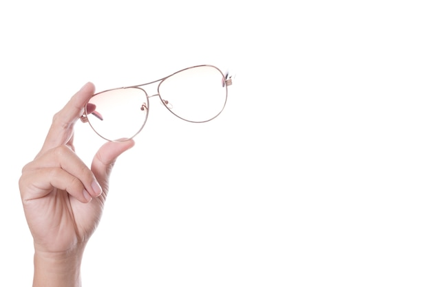 Hand holding vintage glasses Premium Photo